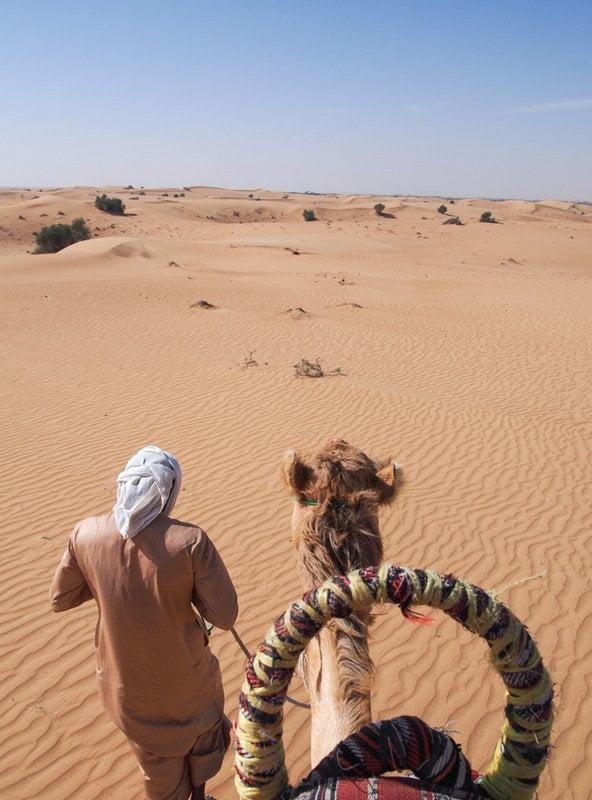 Riding a camel in the Arabian desert