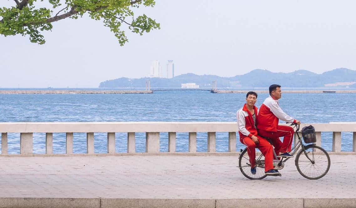 Cycling past, Wonsan, North Korea