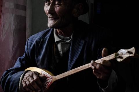 Kazakh Man Playing Dombra