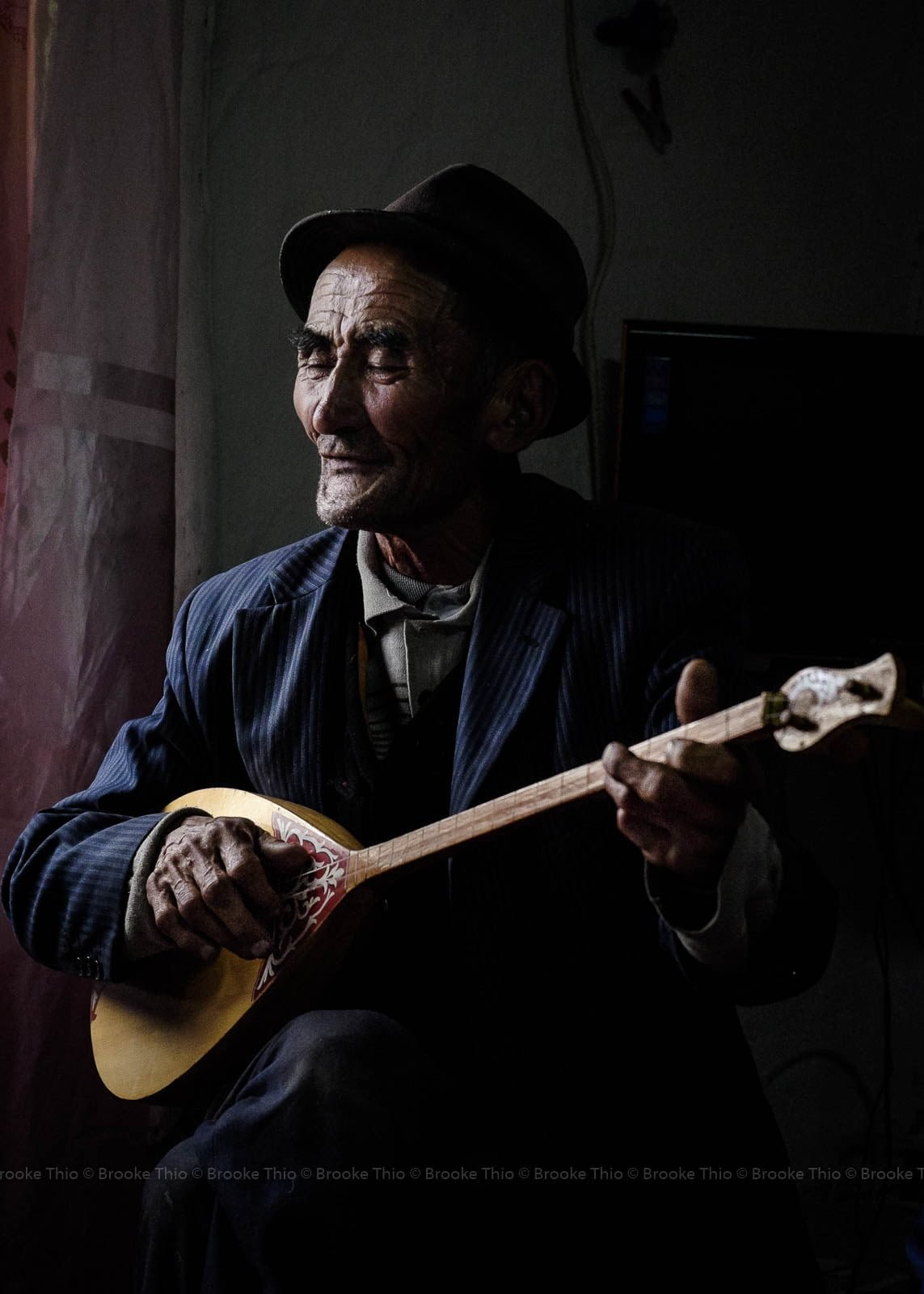 Kazakh Man Playing Dombra