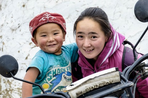 Kazakh neighbor with her daughter