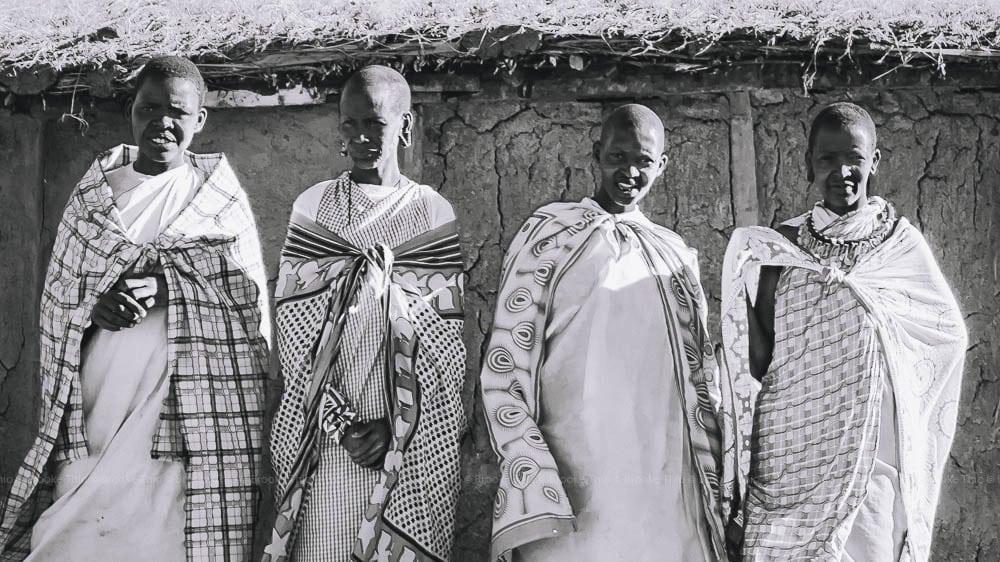 Safari in Kenya: Maasai women perform a song for tourists