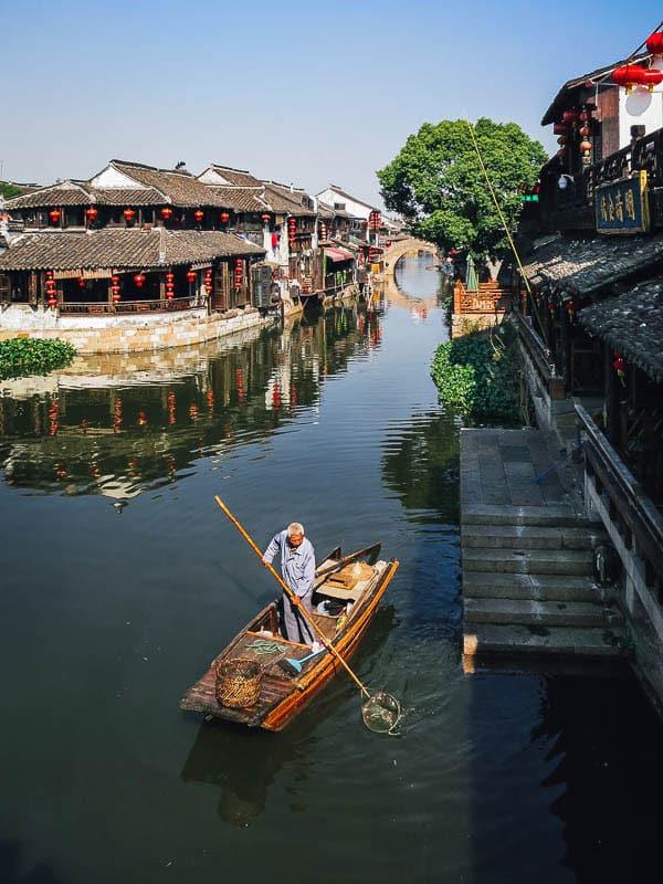 A boatman in Xitang water town.