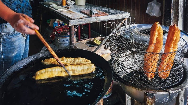 Frying youtiao. Xitang water town, Zhejiang, China