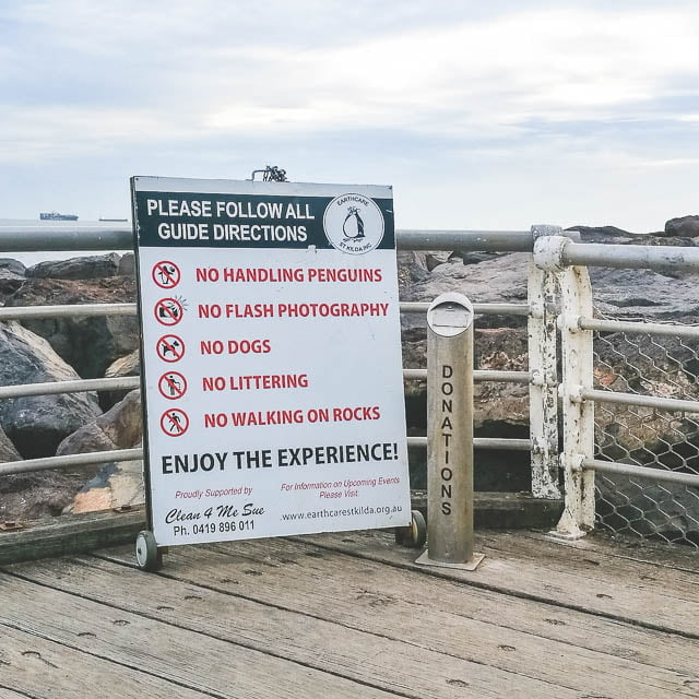 Rules and donation pole for penguins at St Kilda breakwater