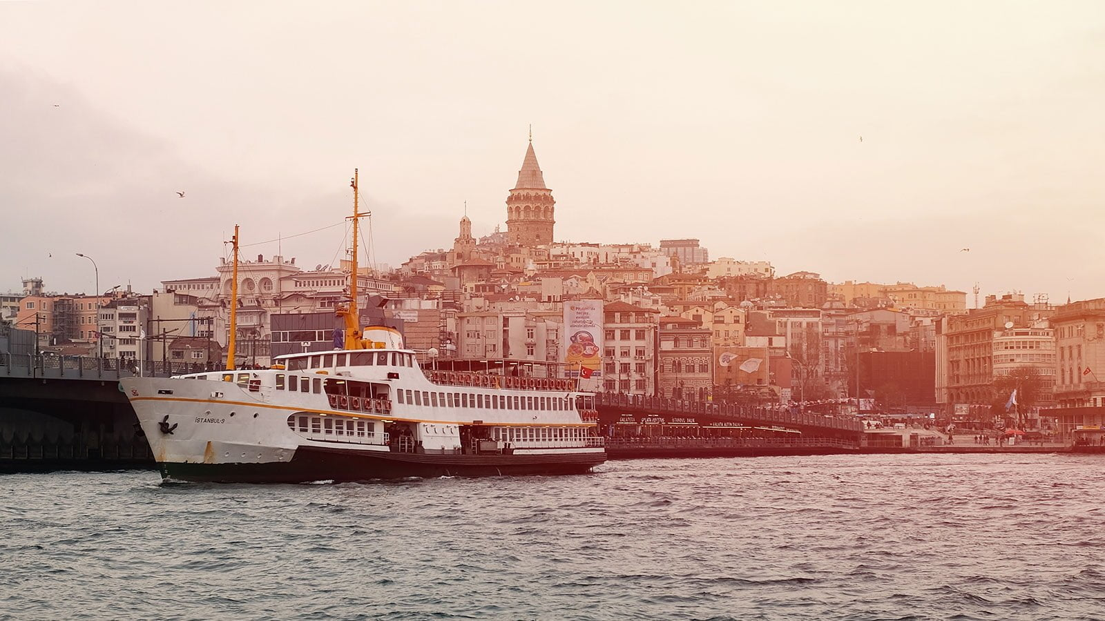 Istanbul ferry and Galata Tower. Photo: Emre Gencer/Unsplash