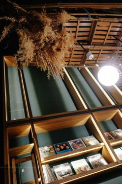 Dried plants hang from the ceiling at U.I.J Hotel & Hostel lobby