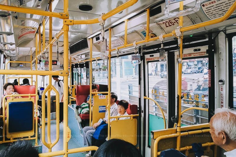 Inside a Taipei public bus where passengers tap their fare cards on boarding.